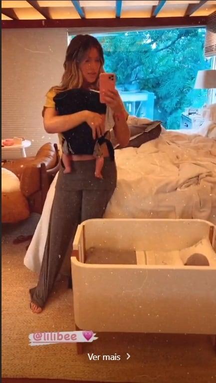 Giovanna Ewbank com seu bebê e o berço dele