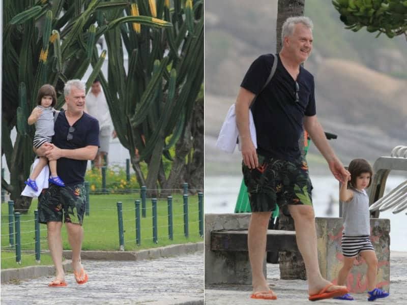Pedro Bial e sua filha durante passeio na praia