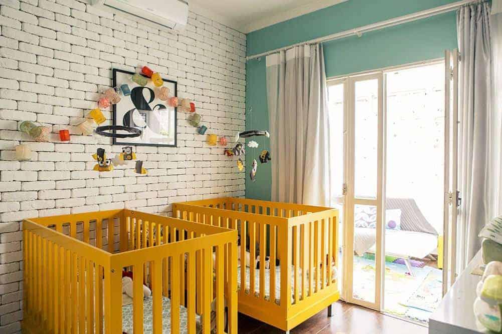 Tom amarelo para quarto de bebê gêmeos