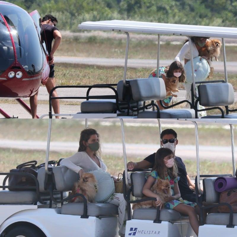 Cauã Reymond retornando de viagem com a esposa e a filha