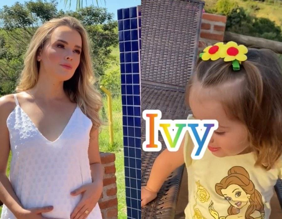 Thaeme grávida e sua filha contando que a bebê é menina
